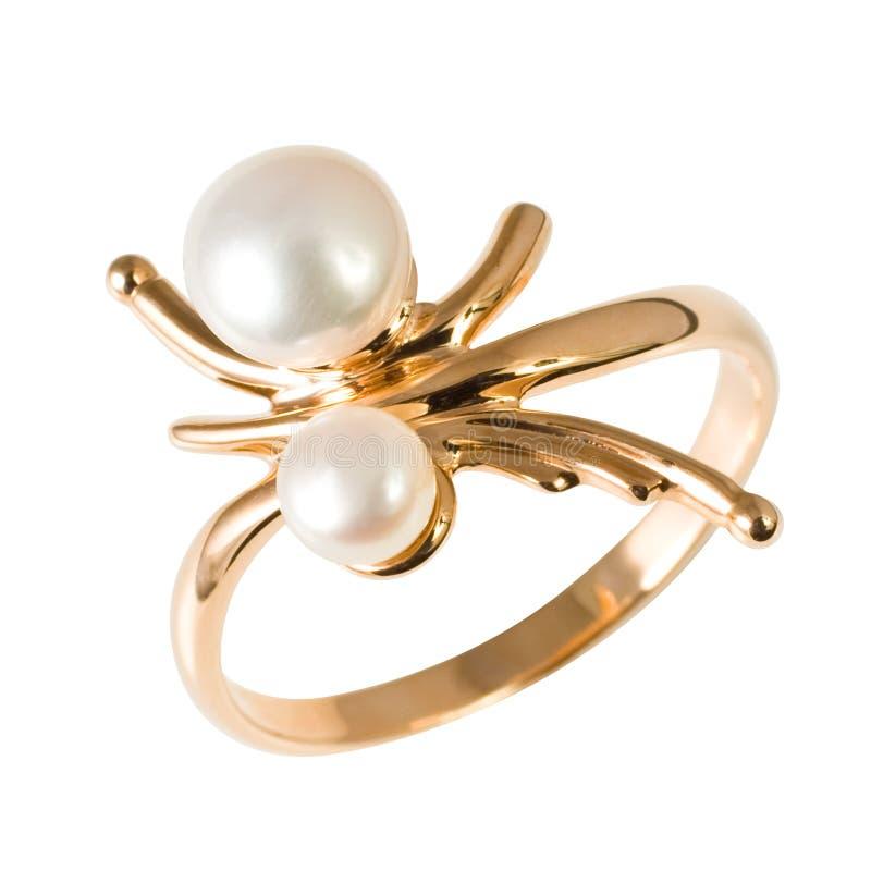 Anello dorato con le perle fotografia stock
