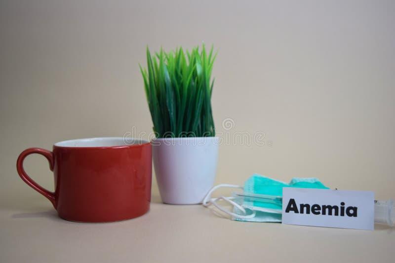 Anemia tekst, trawa garnek, filiżanka, strzykawka i twarzy zielony mas, Healtcare, poj?cie/Medyczny i Biznesowy zdjęcia stock