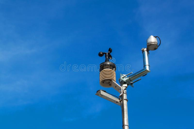 Anemometer on blue sky. Weather measuring instrument wind cup meter and direction. stock photos