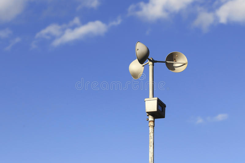 Anemometer on blue sky stock images