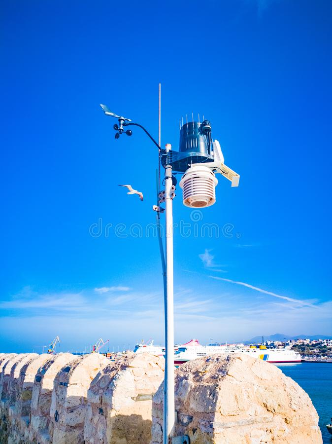 Anemometer Device used for measuring wind speed, common weather station instrument. Wind speed measurement  meteorology concept. A. Nemometer on blue sky stock photo