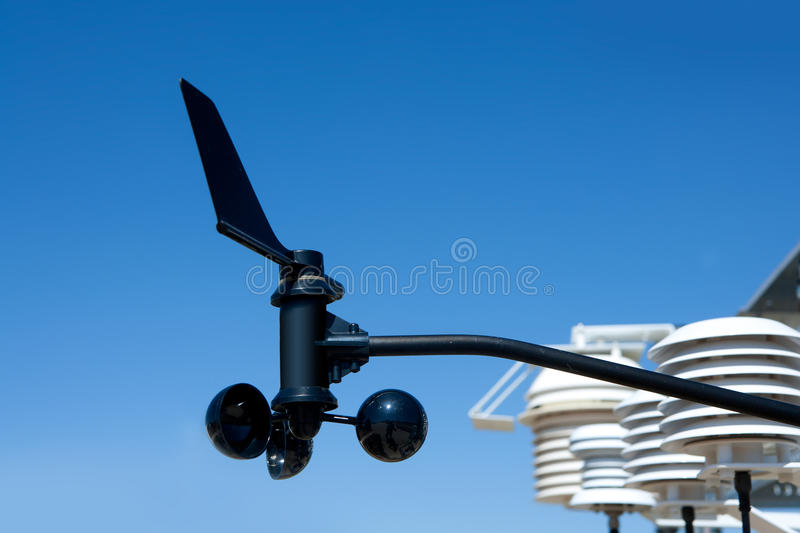 Anemometer vane in weather station. Under blue sky royalty free stock photo