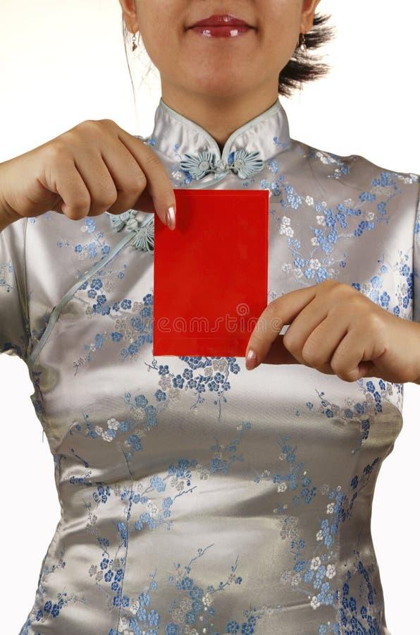 ang azjatykcia mienia pieniądze paczki pow czerwieni kobieta zdjęcia stock