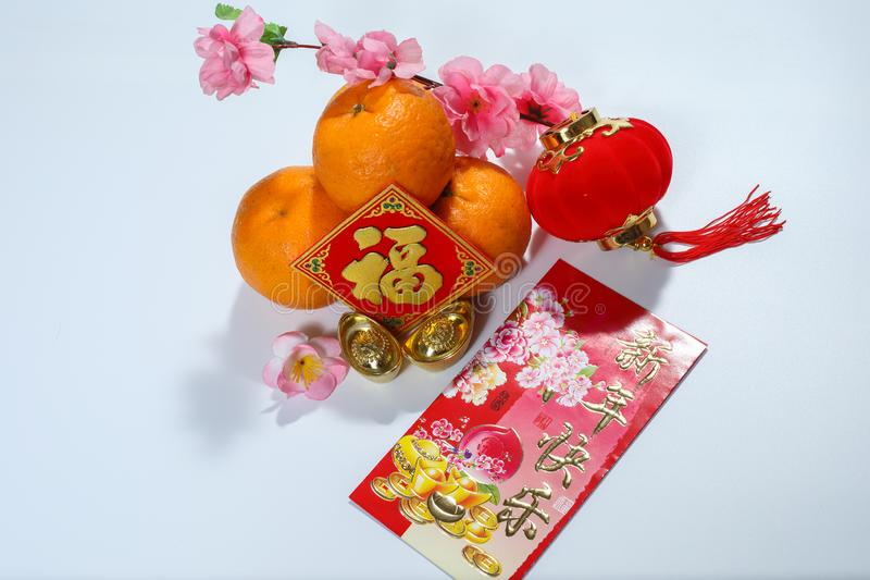 Ang Pao, Chinese decorations with Happy New Year greetings on angpao, Fook and red lantern and oranges stock photo