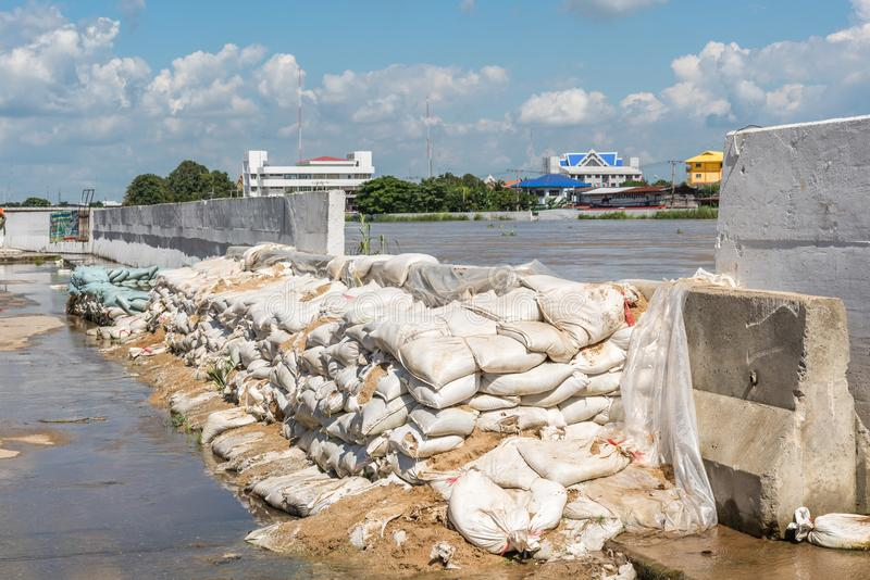 Dams from sand bags prevent flooding from river. Ang Thong, Thailand - October 21, 2017 : Dams created from sand bags. To prevent flooding caused by heavy rain royalty free stock photography