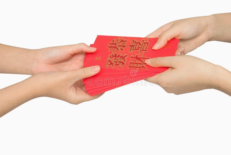 ANG van de handholding pow of de rode gift van het pakketgeld stock fotografie