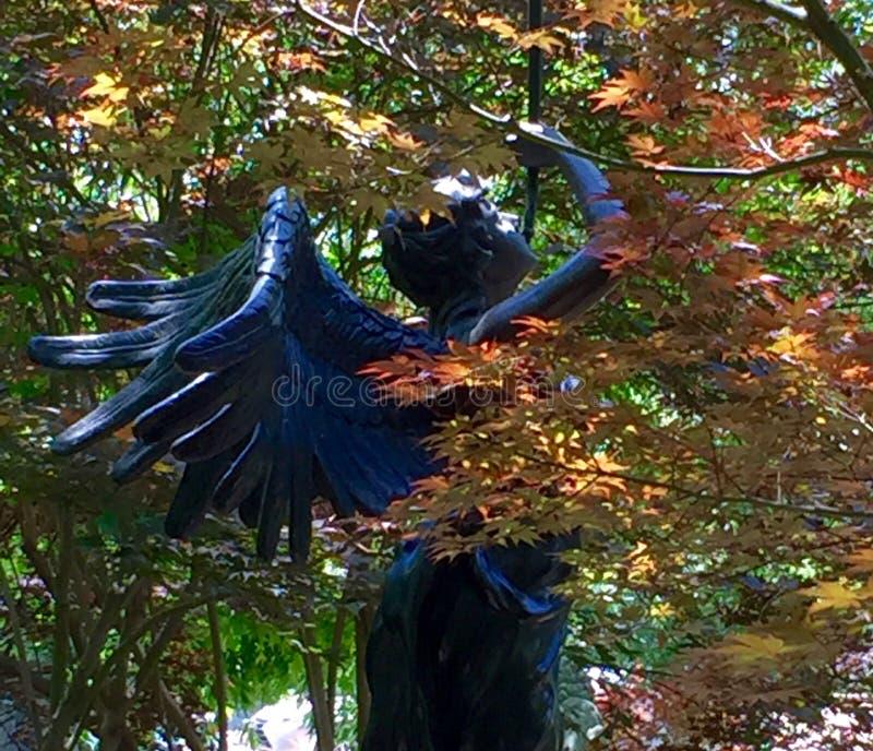 Ange à ailes en métal photographie stock