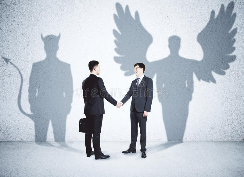 Ange et associés de démon photo stock