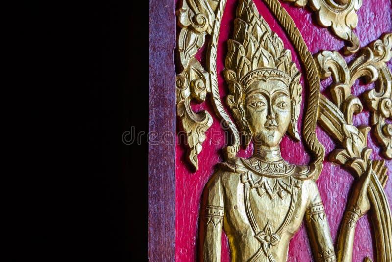 Ange mural antique de porte de Thail photographie stock libre de droits