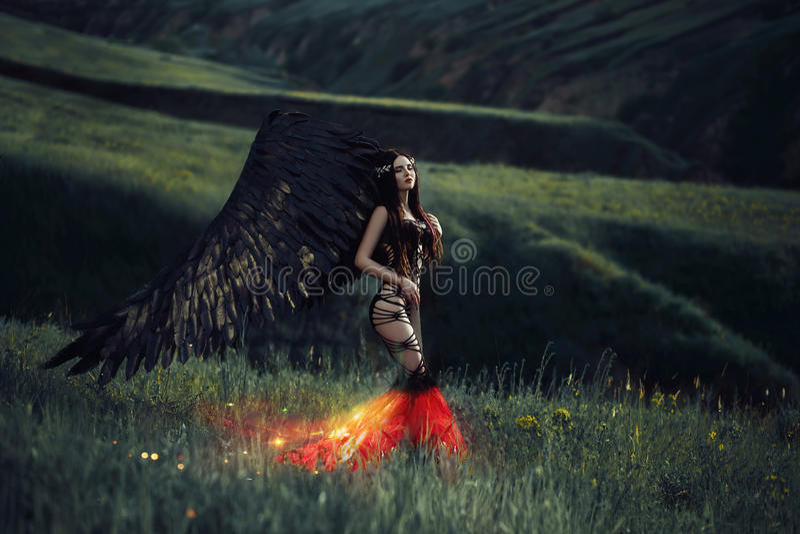 Ange noir Joli fille-démon photographie stock