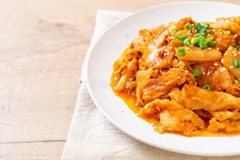 Angebratenes Schweinefleisch mit kimchi lizenzfreie stockbilder