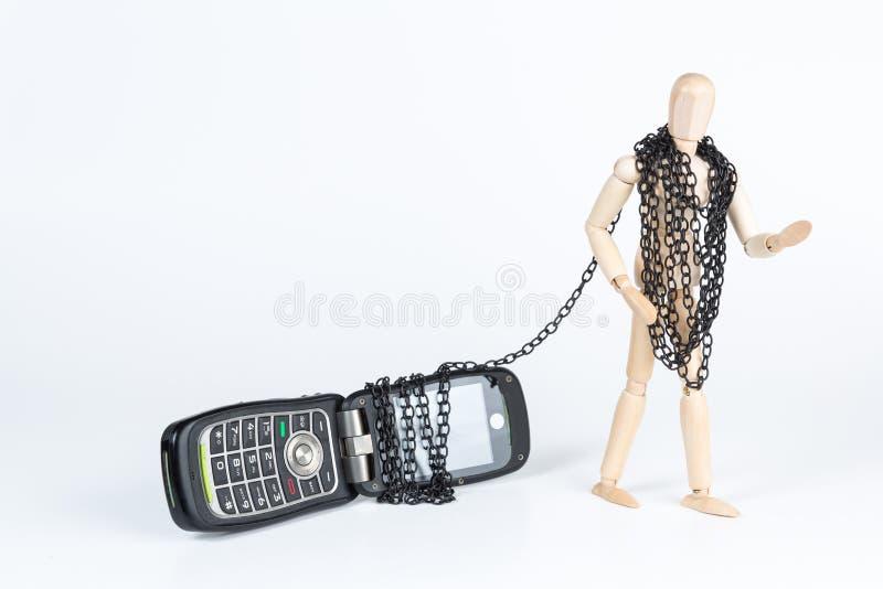 Angekettet an das Telefon stockfotos