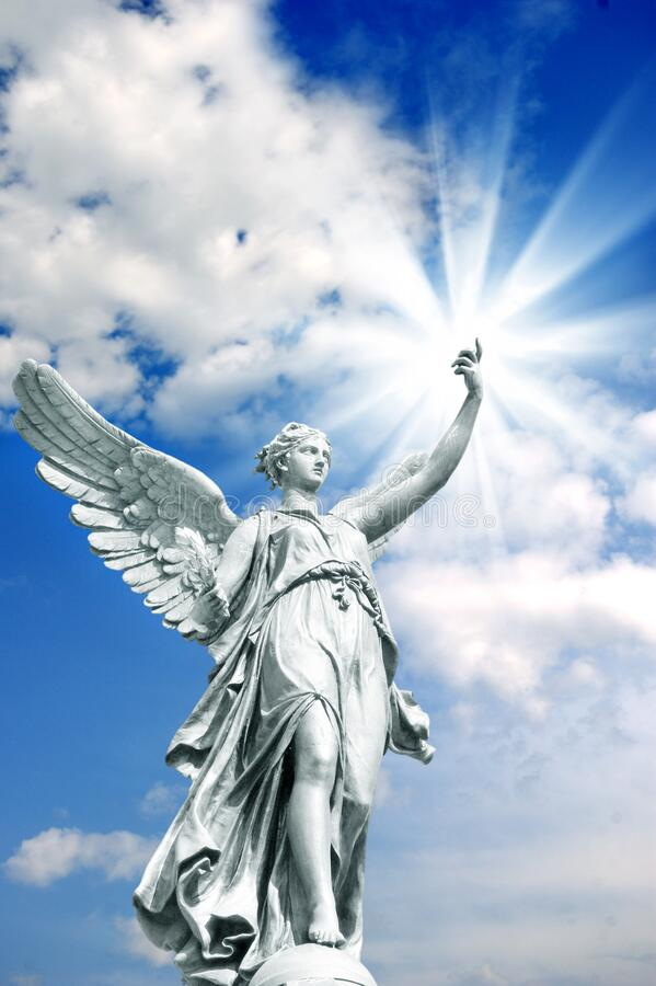 Angel archangel with divine rays of light and beautiful sky stock image