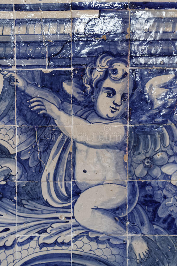 Angel on azulejos in the Palace of Sintra. SINTRA, Portugal, April 7, 2017 : Azulejos in the Palace of Sintra, for a long time the residence of Royal family royalty free stock photos