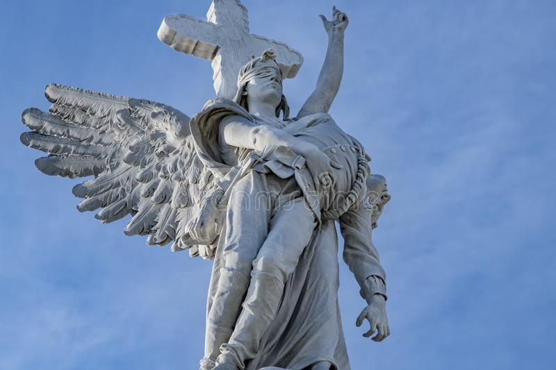 Angel with bandaged eyes and dead firefighter on Cemetery stock image
