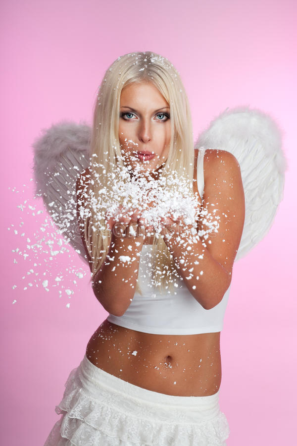 Angel Blow Off Snow From Her Hands Stock Photo