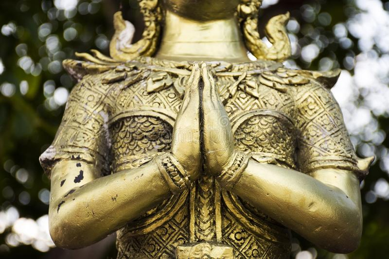 Angel brass statue in garden of Phra That Nadoon Chedi or Na Dun Pagoda for thai people travel visited and respect praying stock image