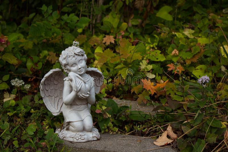 Angel with Bunny Statue stock images