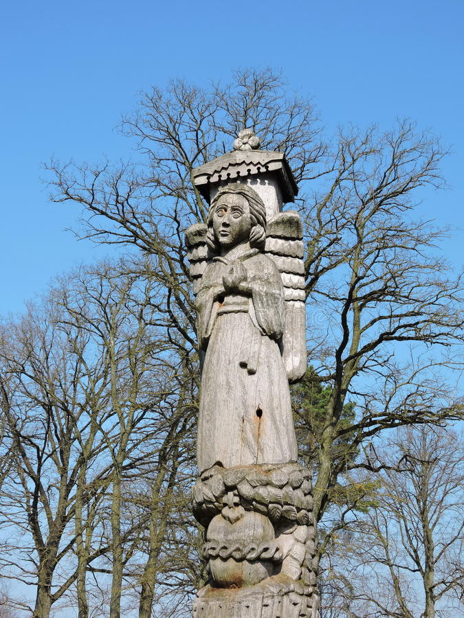 Angel carved from wood. Beautiful angel statue carved from natural wood, Lithuania stock photos