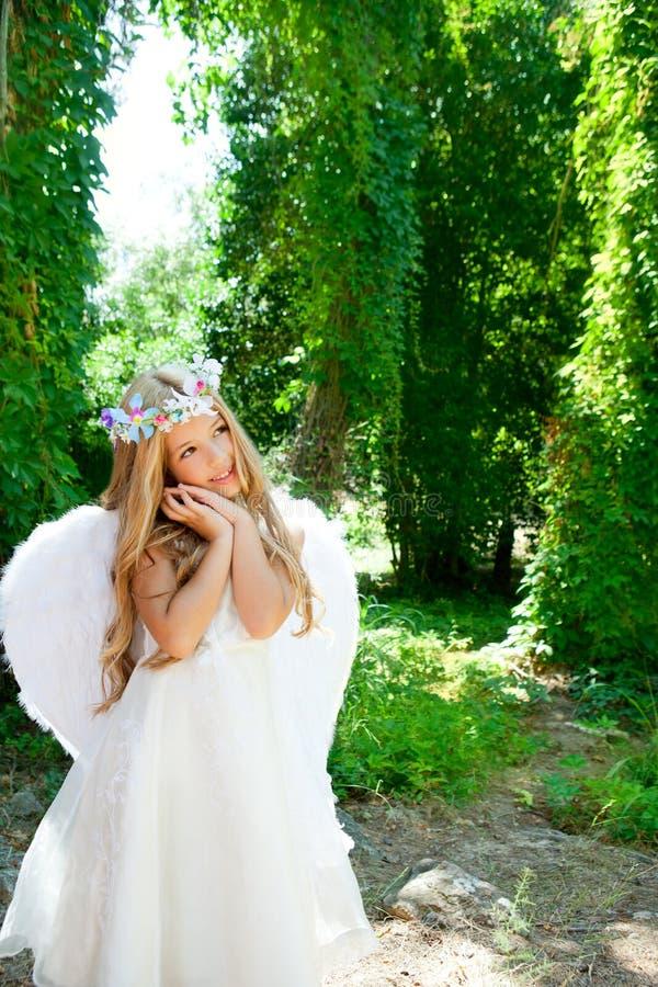 Angel children blond girl gesture stock images