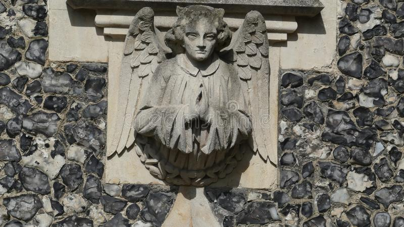 Angel on a church welcoming everyone in stock photography