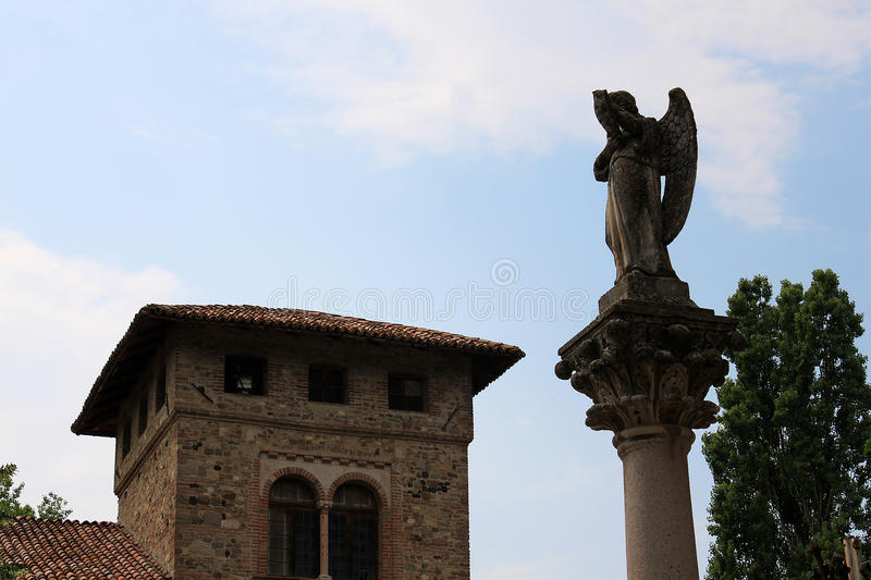 Angel on a column. Medieval house stock photo