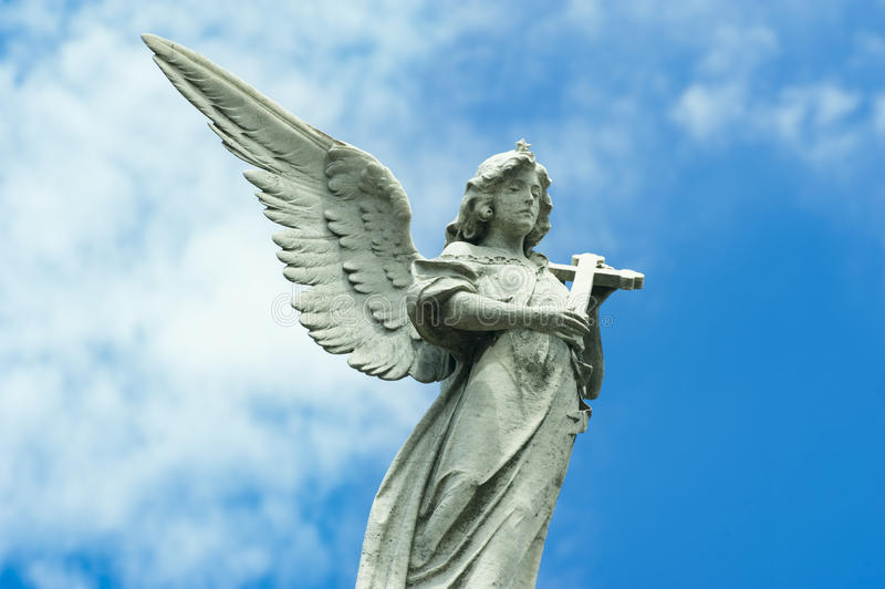 Angel with cross in hands and beautiful wing royalty free stock images