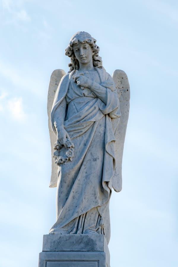 Angel with cross and flower wreath on Cementerio Cristobal Colon in Havana, Cuba stock image