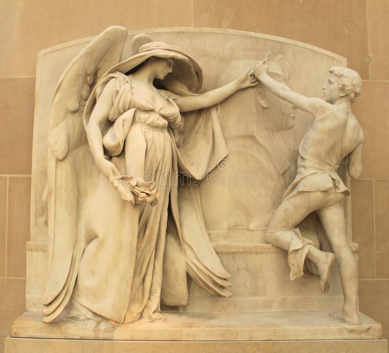 The Angel of death and the sculptor. MET Museum New York City royalty free stock photo