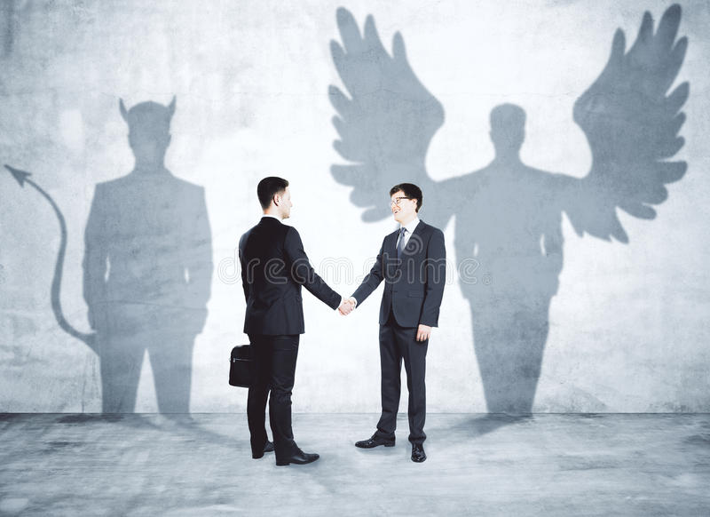 Angel and demon partners stock image