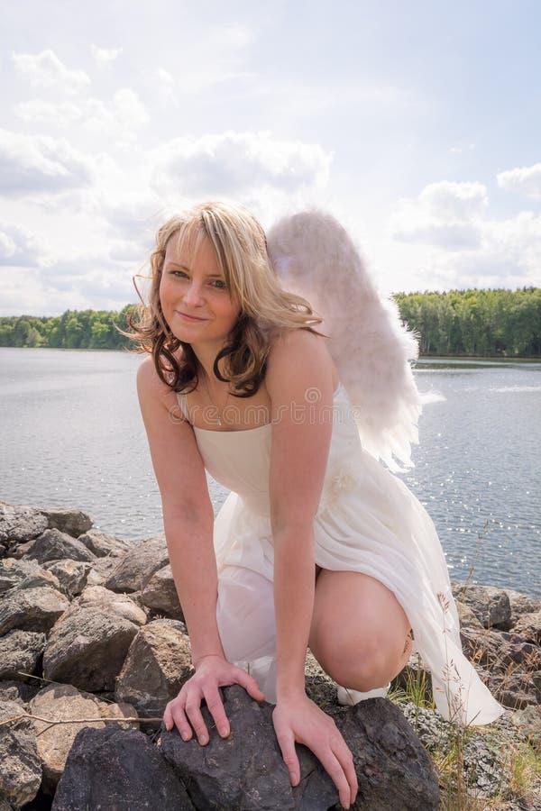 Angel on earth III stock photography