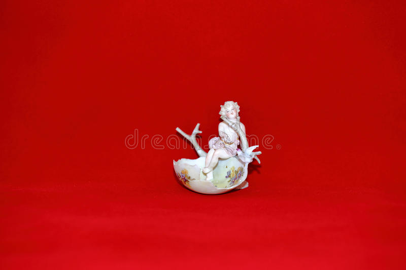Angel in the Easter egg shell. Miniature antique statuette of an angel in the Easter egg shell of the early 20th century stock image