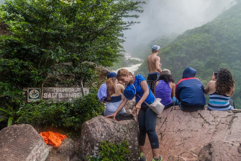Tourists watch Angel Falls stock photography