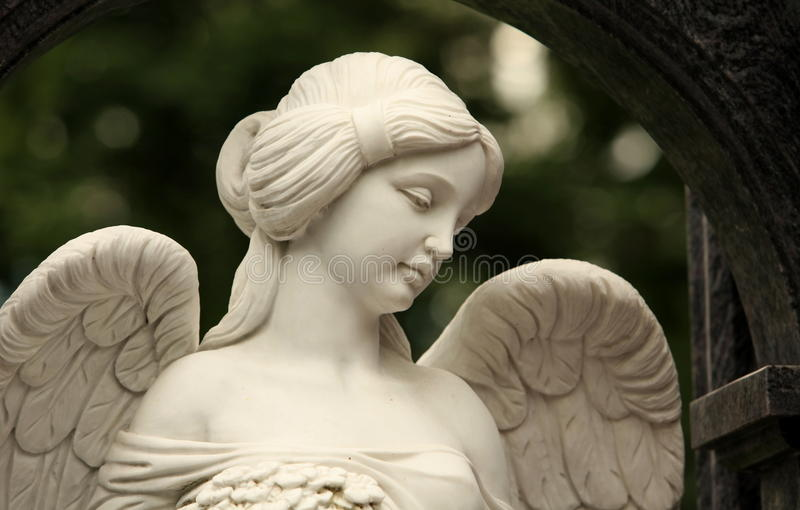 Angel with a female face stock photo