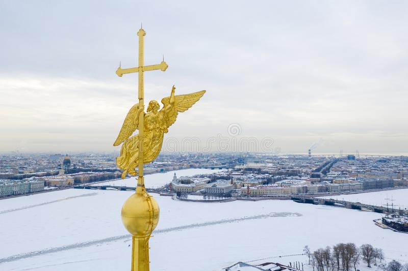 Angel figure and cross on the spire of Peter and Paul Cathedral, Petersburg aerial view.  royalty free stock images