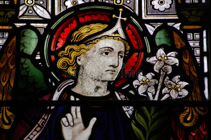 Angel Gabriel. Victorian stained glass window showing the Angel Gabriel. Window created in the mid 19th century, on public view in a church in Hampshire royalty free stock images