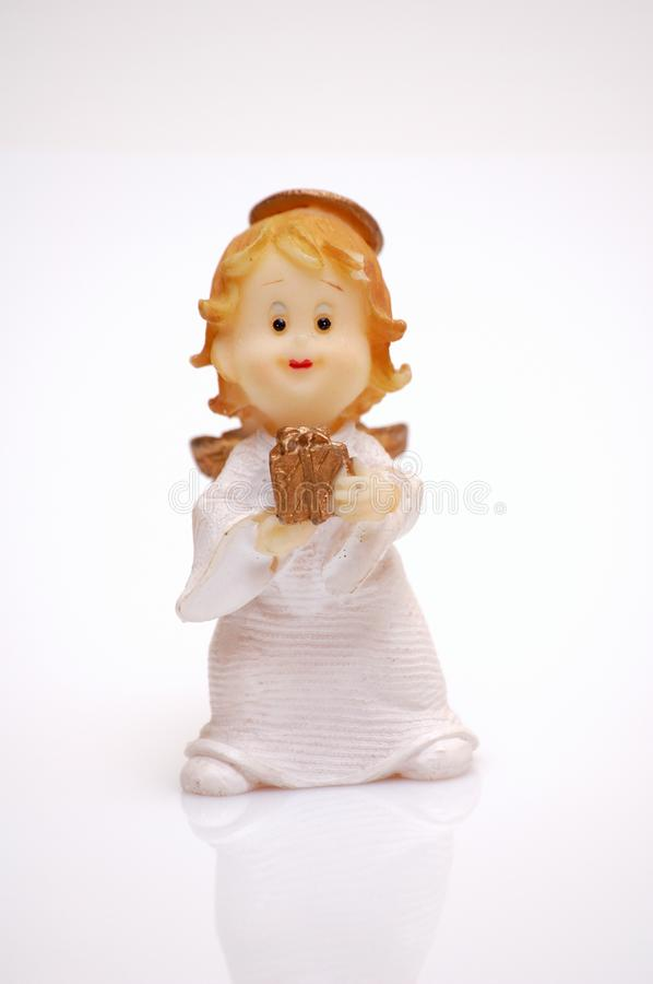 Angel with a gift stock photo