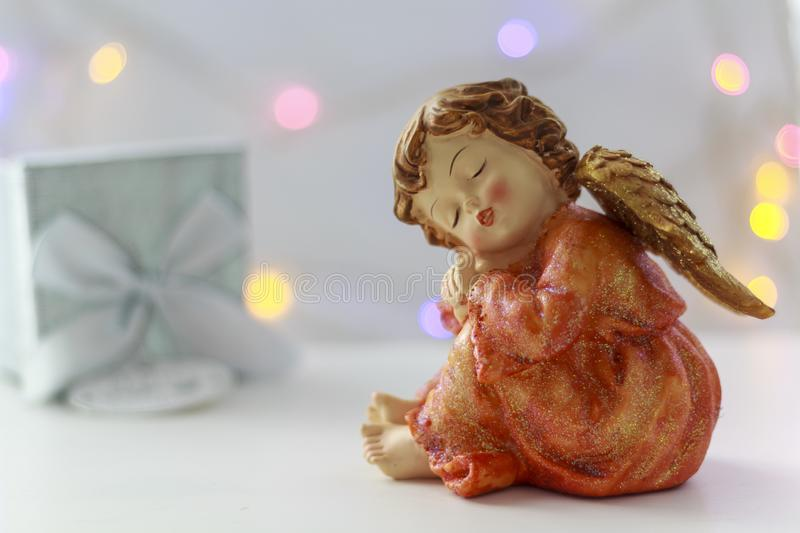 Angel with gift box on the background stock photo