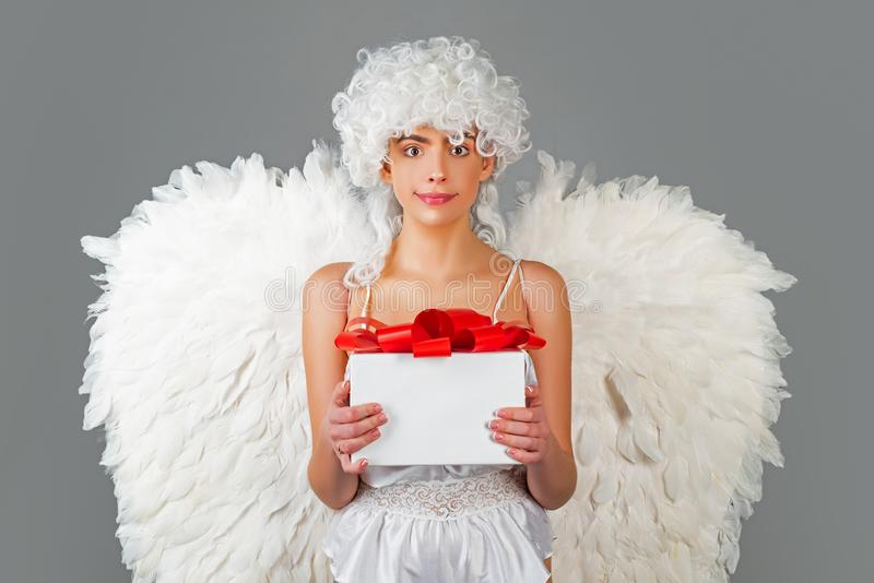 Angel with gift. Valentines cupid. Valentine`s Day: Gift, Romantic and Date. Romantic Gifts and Valentines Gift Ideas. royalty free stock photos