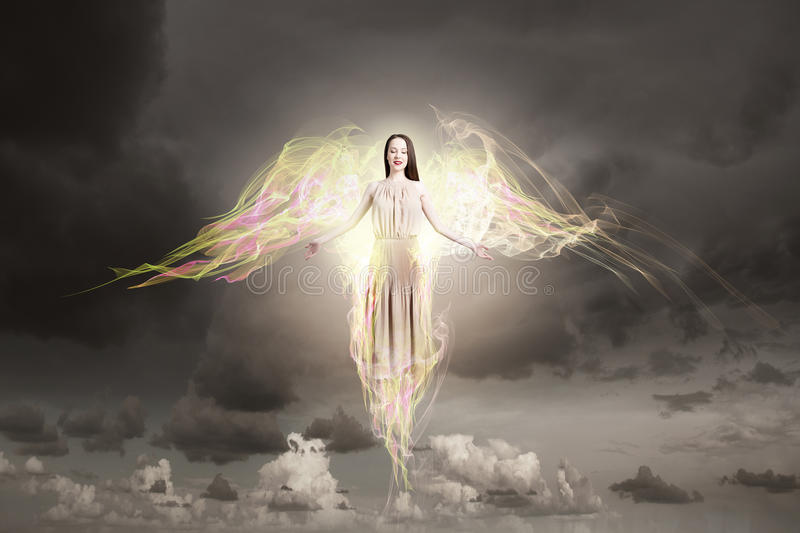 Angel girl flying high royalty free stock photo