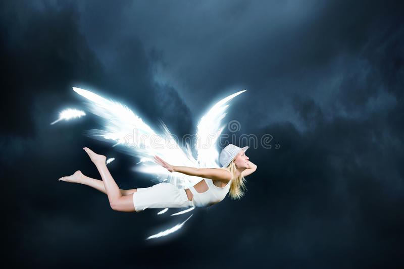 Angel girl flying high stock photos