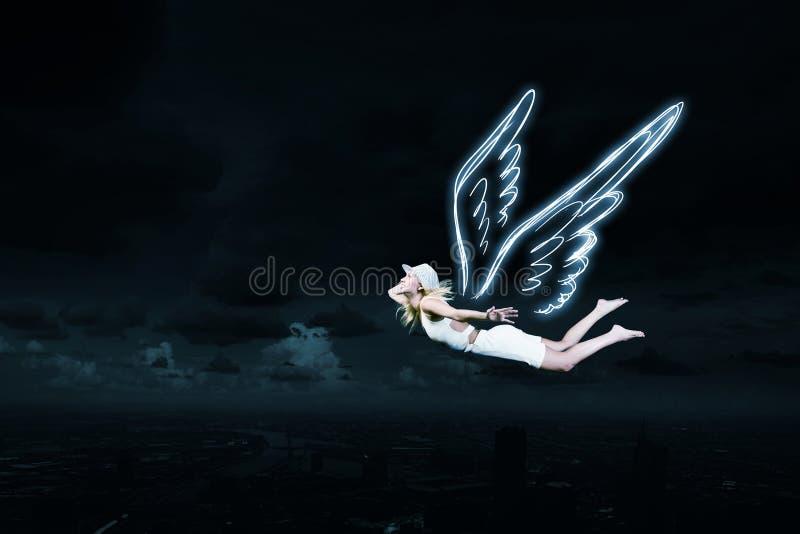 Angel girl flying high stock photo