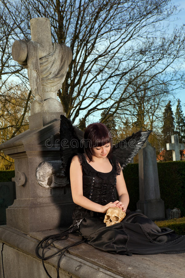 Angel on a grave stock images