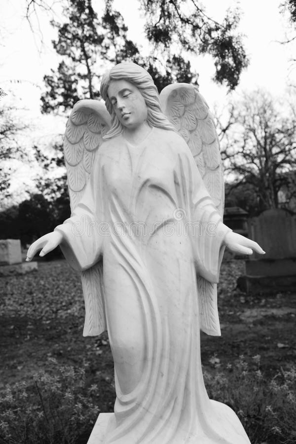 Angel Gravestone. Angel on cemetery headstone. Black and white image. Historic Greenwood Cemetery, Dallas Texas, US royalty free stock photography