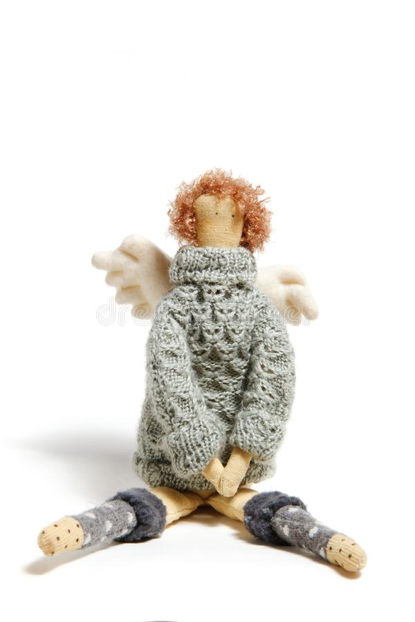 Angel handmade doll in sweater stock photography