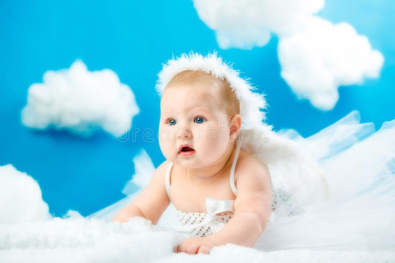 The baby as the angel soaring in clouds royalty free stock photo