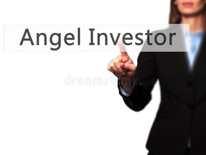 Angel Investor - botón del presionado a mano de la empresaria en el SCR del tacto fotografía de archivo