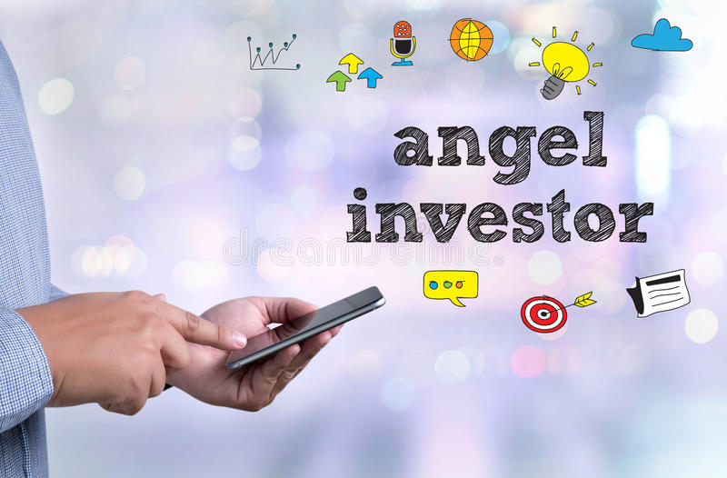 Angel investor. Person holding a smartphone on blurred cityscape background stock photography