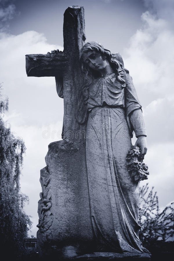 Download Angel leaning on cross stock photo. Image of historical - 32025728