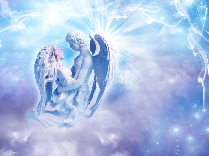 Angel love. Two embracing angels like a concept of angelic love royalty free stock photography